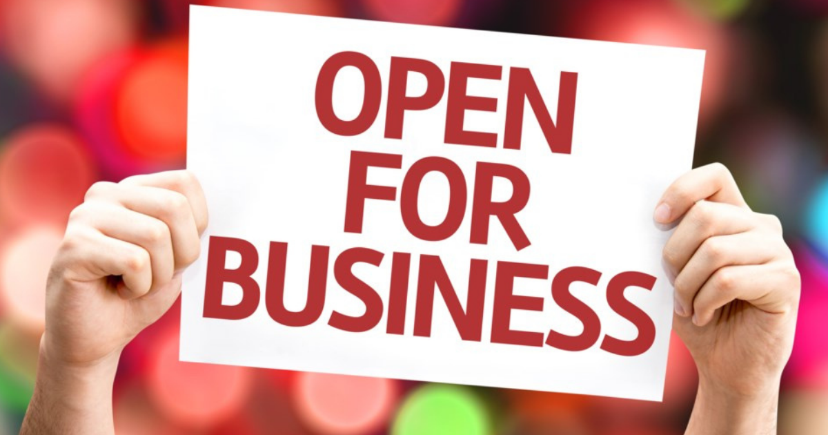 Open for business sign in red writing